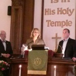Pastor Donna-after being elected the new Pastor of WNPC, her husband-PJ, and Pastor John Potter